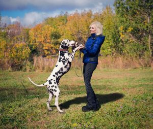 Girl dancing with a Dalmatian