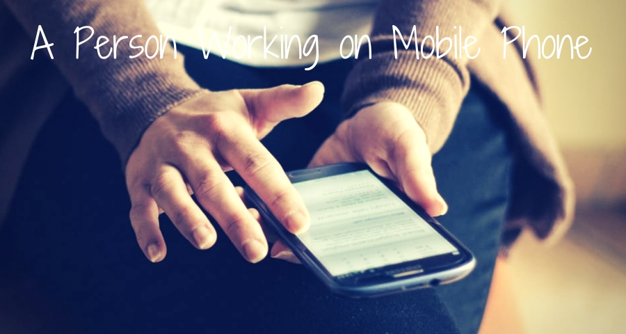 A Person Working on Mobile Phone